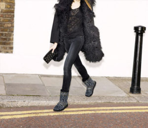 Woman in black ugg boots